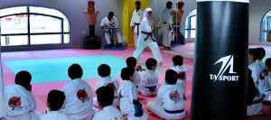women Karate student showing her skill at event