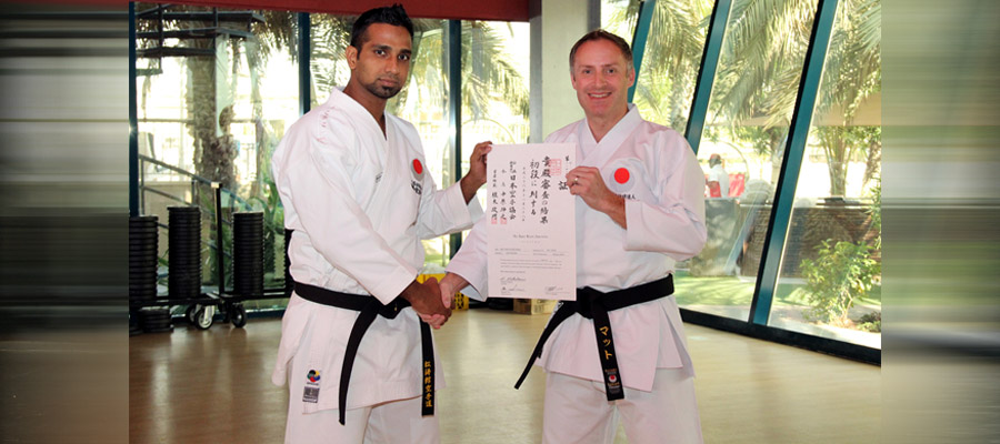 Master Shan with black belt holder