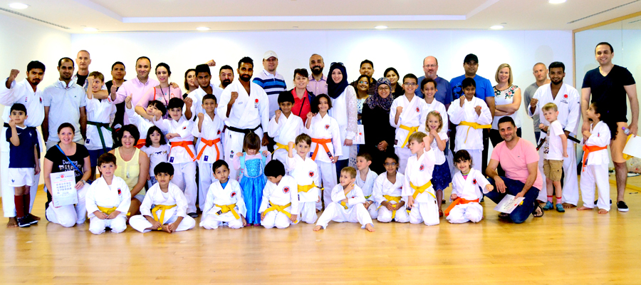 Group photo of karate students and instructors at emirates karate centre